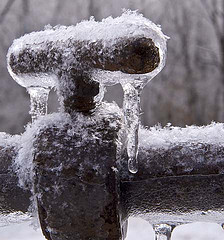 a frozen pipe covered in ice